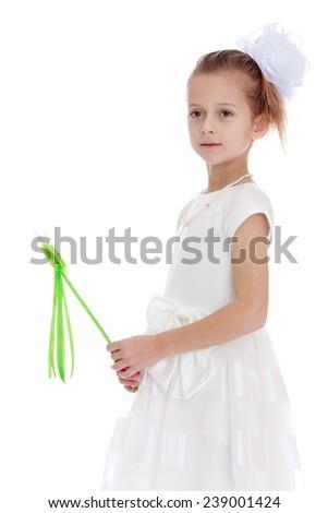 Girl holding a magic wand. Studio photo, isolated on white background. - stock photo