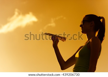 Girl holding a paper airplane.  - stock photo