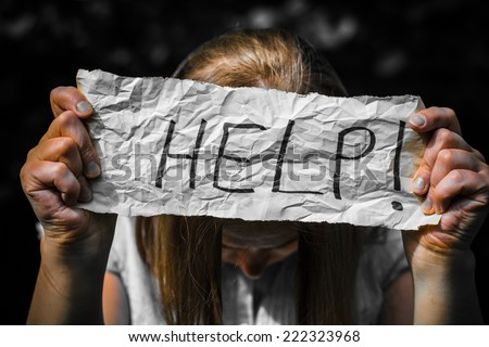 girl holding a paper with the inscription. - stock photo