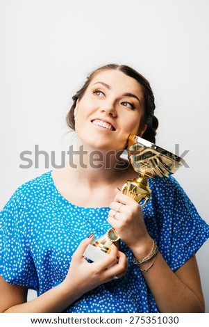 girl holding a prize cup - stock photo