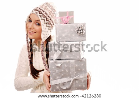 Girl holding a stack of presents on white background - stock photo