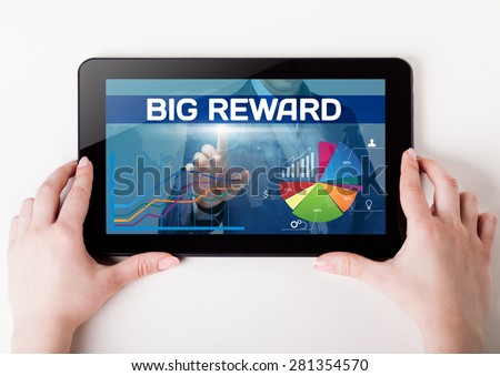 Girl holding a tablet pc which a man presses the virtual screen with text big reward. Technology, business, internet, concept.