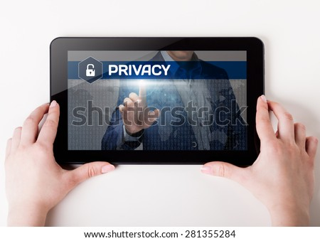 Girl holding a tablet pc which a man presses the virtual screen with text privacyy. Technology, business, internet, concept.