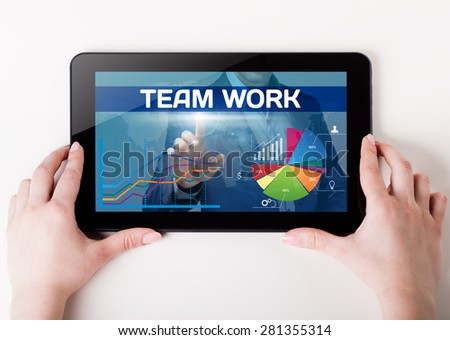 Girl holding a tablet pc which a man presses the virtual screen with text team work. Technology, business, internet, concept.