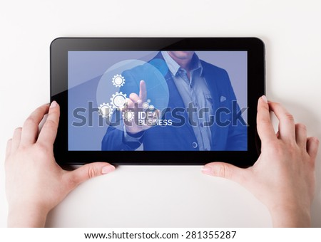 Girl holding a tablet pc which a man presses the virtual screen with text . Technology, business, internet, concept.