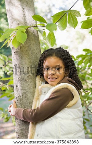 Girl holding a tree - stock photo