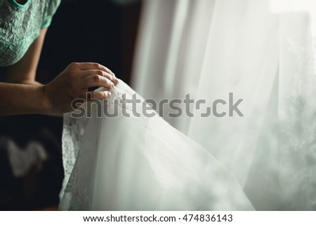 girl holding a wedding white  dress