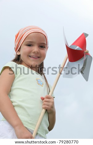 Girl holding a windmill - stock photo