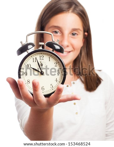 girl holding an alarm clock on a white background