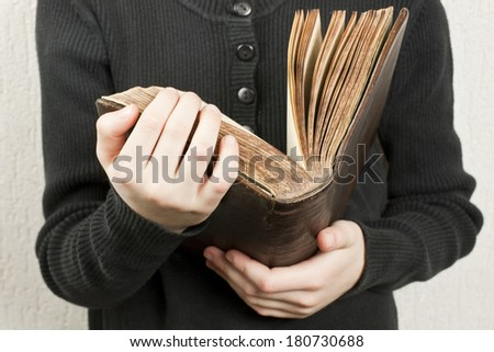 girl holding an open old book - stock photo