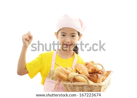 Girl holding breads - stock photo