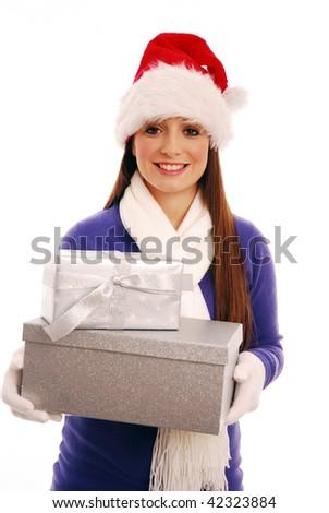 Girl holding christmas presents - stock photo