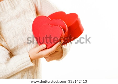 Girl holding cute red hearts on white. Valentine concept.