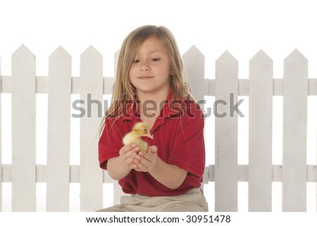 Girl holding ducklings
