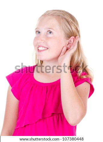 girl holding ear listening, isolated on white - stock photo