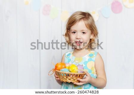 girl holding Easter basket - stock photo