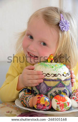 girl holding Easter cake - stock photo