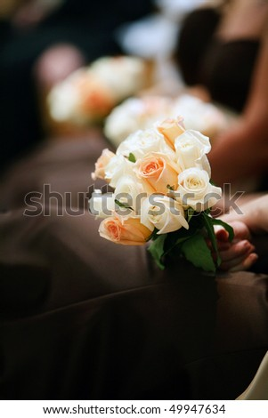 girl holding elegant rose bouquet, wedding ceremony - stock photo