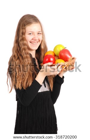Girl holding fresh fruits isolated on white