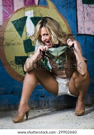 girl holding gas mask - stock photo