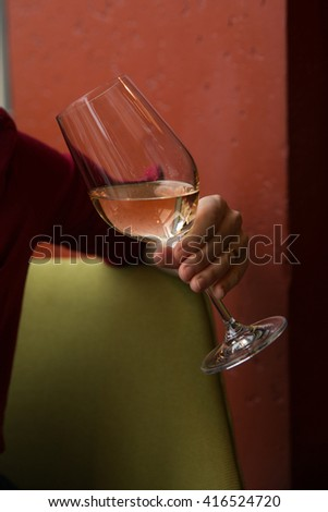 Girl holding glass of white wine