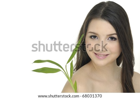 girl holding green bamboo in her hands - stock photo