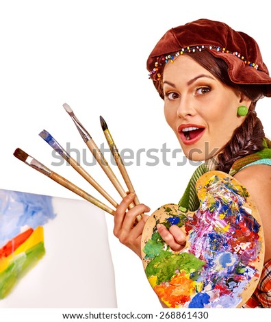 Girl holding hands on the background of the easel. Isolated. - stock photo