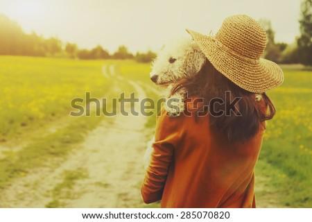 girl holding her dog - stock photo