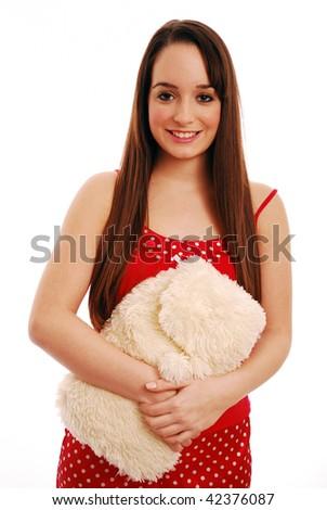 Girl holding hot water bottle on white background - stock photo