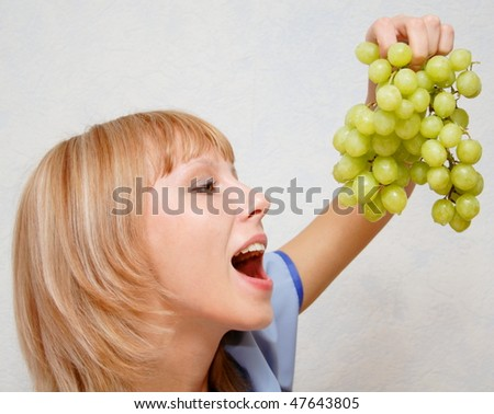 Girl holding in her hand a vine. - stock photo