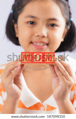 Girl holding mom letters box