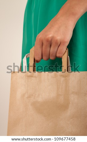 Girl holding paper bags. Consumerism symbol. - stock photo