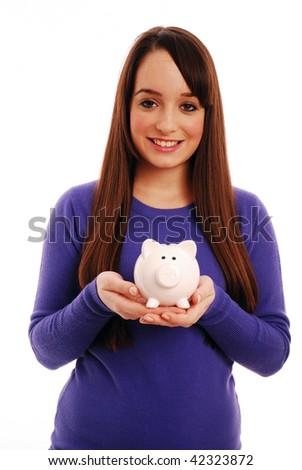Girl holding piggy bank - stock photo