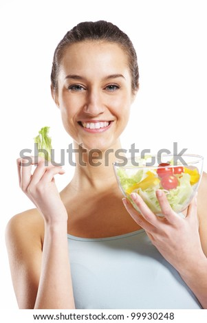 girl holding plate with salad on white background