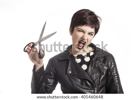girl holding scissors - stock photo