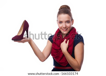 girl holding shoe in hand an looking with love on it, over white - stock photo