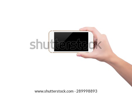 Girl holding the gold phone upright in her right hand