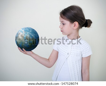 Girl holding the Planet Earth. Future Concept - stock photo