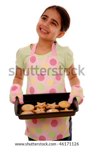 Girl holding tray of freshly baked cookies