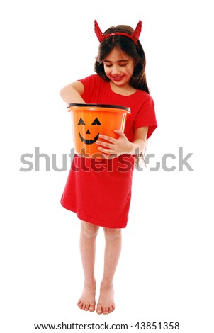 Girl holding trick or treat bucket isolated on white