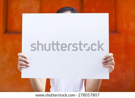 Girl holding white board