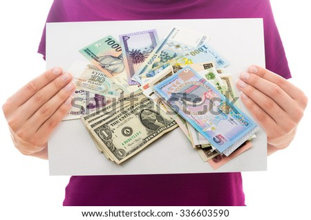Girl holding white paper sheet with Photo of money - stock photo