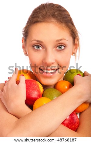 Girl holds fruit in hands and smiles, it is isolated on white background. - stock photo