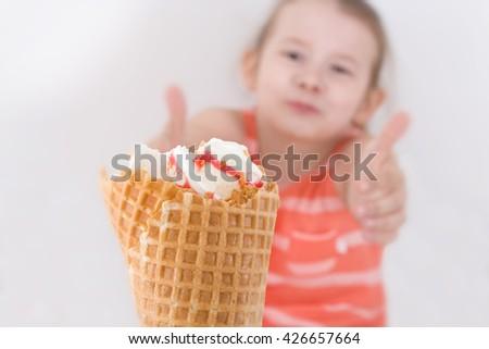 Girl holds hands for ice cream - stock photo