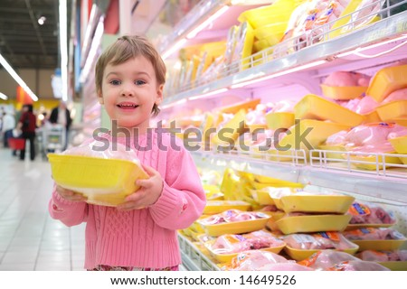 girl holds in hands packing with  hen in shop