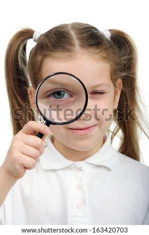 Girl holds in his hand a magnifying glass