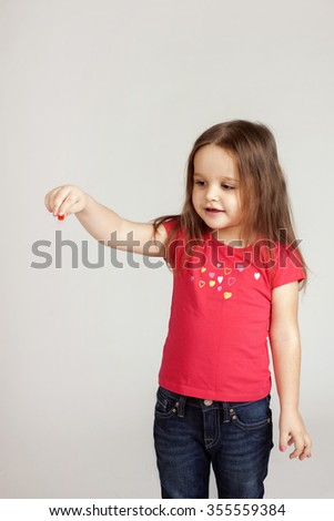 Girl holds something from her hand. Copy space. - stock photo