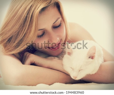 girl hugging a cat - stock photo