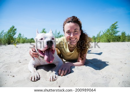 Girl hugging dog breed Staffordshire Terrier - stock photo