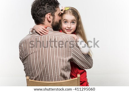 Girl hugging her father  over a white background - stock photo